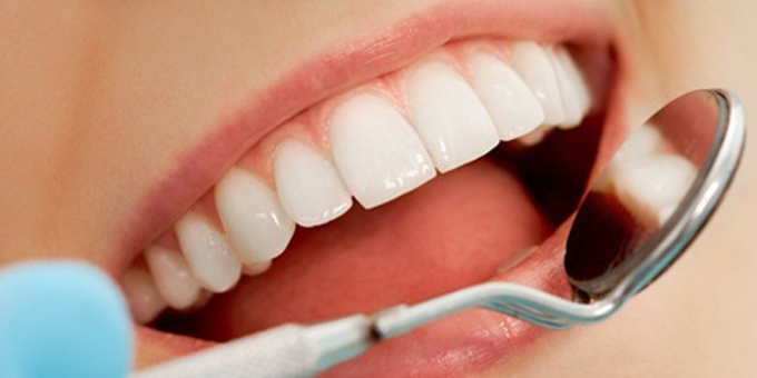 Hamilton dentists bare teeth over fluoride