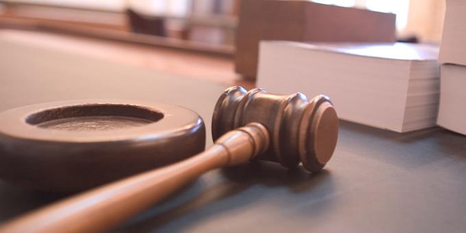 Board works on despite court case