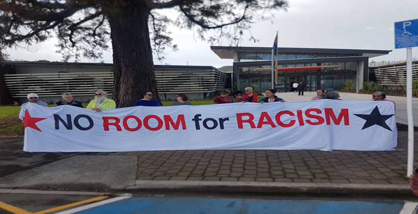 Racism reaction in breach of council conduct