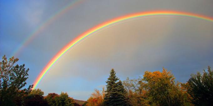 Rainbow over charred marae